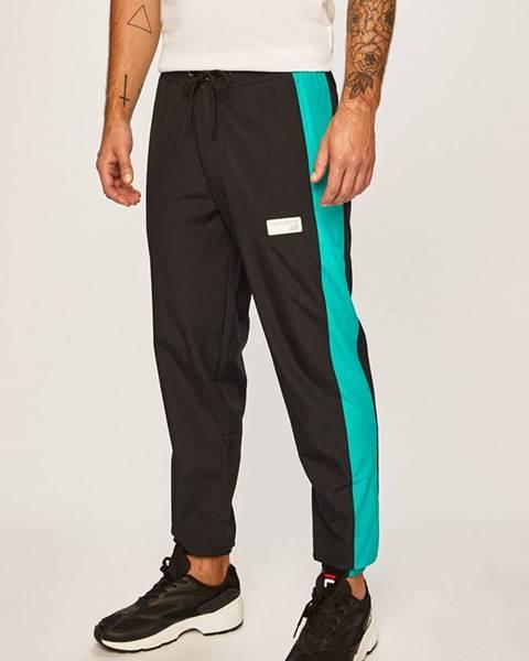 Zelené nohavice New Balance